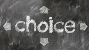 Picture of the word choices drawn in chalk for blog about Insurance Personalization