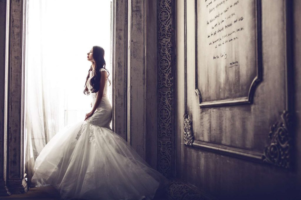 woman in wedding gown for a blog about wedding insurance